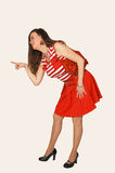Lady standing in studio with red purse. Stock Image