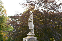 Lady statue on grave. In cemetery Royalty Free Stock Photo