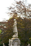 Lady statue on grave. In cemetery Royalty Free Stock Images