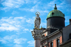 Lady statue on a pole with blue sky Royalty Free Stock Photo