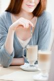 Lady is stirring the milk shake Stock Image