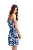 Lady in strapless floral dress. Garment of blue color. Beautiful and sad model. Stylish print on light fabric Stock Photography
