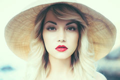 Lady in straw hat. Portrait of a beautiful young lady in a straw hat Royalty Free Stock Image