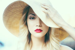 Lady in straw hat Royalty Free Stock Images