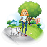 A lady strolling with her dog Royalty Free Stock Image