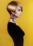 Lady with stylish hairdo. Fashion art photo of beautiful lady with stylish hairdo royalty free stock photography