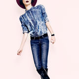 Lady in a stylish jeans clothes. Stock Photography
