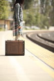 A lady with a suitcase Stock Photos