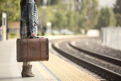 A lady with a suitcase Royalty Free Stock Photo