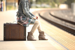 A lady with a suitcase. A lady waiting at the railway station with a retro suitcase Stock Photos