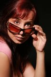 Lady in sun glasses. Charming lady in sun glasses on black background Royalty Free Stock Photo