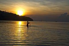 Lady with sunrise Stock Image