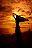 Lady in sunset Stock Photography