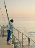 Lady on sunset cruise Kauai royalty free stock photography
