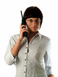 Lady from support service. Young attractive lady holding cordless phone looking camera Royalty Free Stock Photography