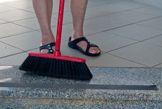 Lady sweeping the marble floor Royalty Free Stock Photography