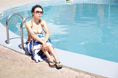 Lady at swimming pool Royalty Free Stock Photography