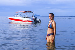 Lady swimsuit and boat Stock Image