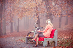 Lady with tablet in park. Stock Images
