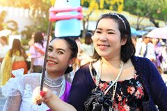 Lady take a picture happily,portrait chubby woman cute taking selfie by smartphone so happiness in park royalty free stock photos