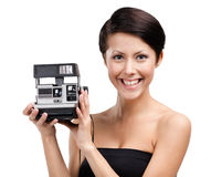 Lady takes photos with cassette camera Stock Image