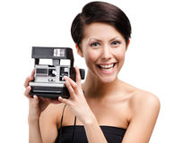 Lady takes pictures with cassette photographic camera Royalty Free Stock Image