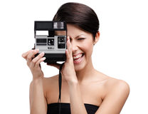 Lady takes snaps with cassette photographic camera Stock Image
