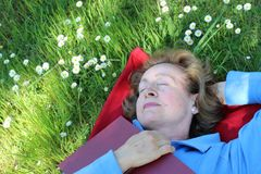 Lady taking a nap outdoors royalty free stock photos