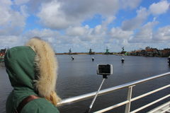 Lady taking selfi at the central bridge of Zaanse schans Royalty Free Stock Images