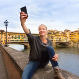 Lady taking selfie in Florence. Royalty Free Stock Images