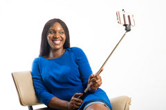 Lady taking selfie with a stick Stock Photos
