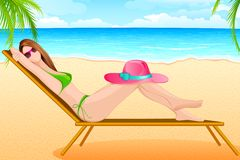 Lady taking sunbath in Beach Chair Royalty Free Stock Photos