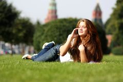 Lady talking on mobile phone. Happy young lady talking on mobile phone Stock Images