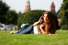 Lady talking on mobile phone. Happy young lady talking on mobile phone Royalty Free Stock Photos