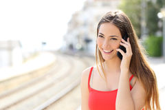 Lady talking on the mobile phone in a train station Royalty Free Stock Images