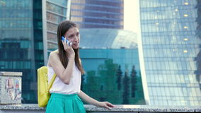 Lady talking on the mobile phone stock footage