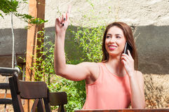 Lady talking at phone and ordering on terrace Royalty Free Stock Photos