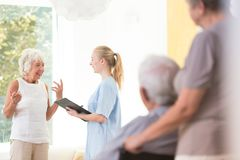 Lady talking to nurse royalty free stock images