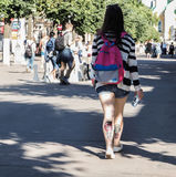 Lady with a tattoo on the calf is in the summer the city centre. Rear view. City life. Saint-Petersburg. The summer of 2017. Stock Photo