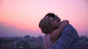 Lady tenderly and gently hugging her boyfriend dissolving in warmth of his body stock photo