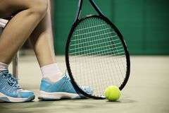Lady tennis player sitting in the court during game break stock photography