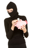 Lady thief putting five euro in piggy bank Stock Image