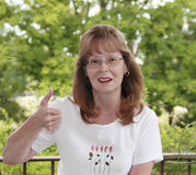 Lady With Thumbs Up Stock Photos