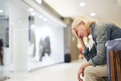 Lady tired from shopping in mall stock image