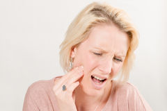 Lady with Toothache in Pain and Touching Right Cheek Stock Photos