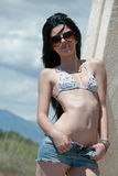 Lady with top bikini enjoying under the heat of the sun Royalty Free Stock Photography