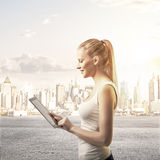 Lady with  touch pad. On city background Royalty Free Stock Photography