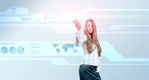 Lady touching hi-tech Stock Images
