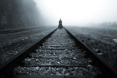 Lady at train rail in the mist Royalty Free Stock Images