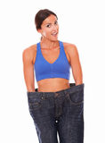 Lady in training clothes measuring body shape Stock Image